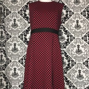 Red sheath dress with black polka dots
